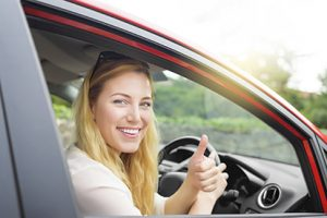 woman-in-driving-seat-with-thumbs-up