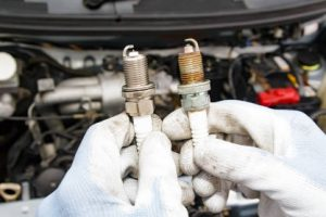 Mechanic Replacing Vehicle Spark Plug